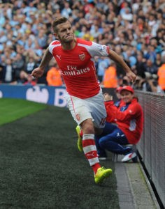 LONDON, ENGLAND - SEPTEMBER 13: Jack Wilshere celebrates scoring for Arsenal during the Barclays Premier League match between Arsenal and Manchester City at Emirates Stadium on September 13, 2014 in London, England. (Photo by Stuart MacFarlane/Arsenal FC via Getty Images)