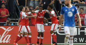 Chuna Akpom celebrates with Arsenal teammates