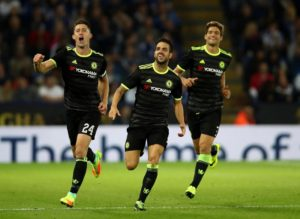 Cesc Fabregas celebrates with Chelsea teammates